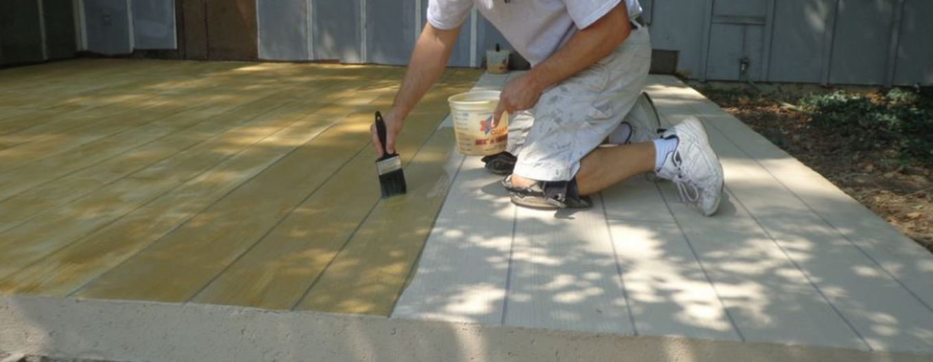 an image of a concrete contractor resurfacing a patio in elk grove, ca