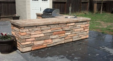 stacked stone contractor build this countertop and installed a barbecue