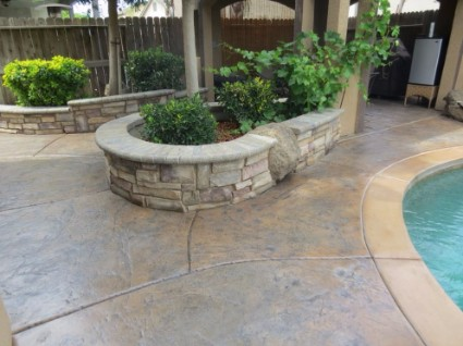 an image of a concrete driveway and patio installation in Orangevale, ca