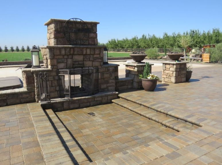 This is a picture of fireplace masonry work and a stamped concrete patio in Granite Bay, California