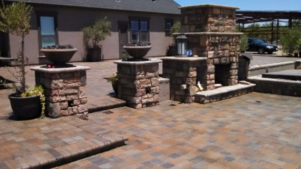 stacked stone pillars, and fireplace done by a Granite bay Stone Contractor